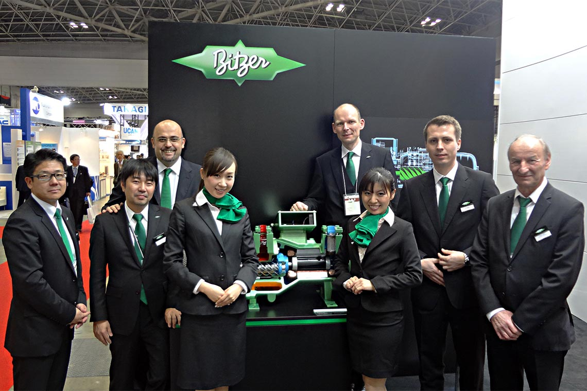 HVAC&R 2014 – the first event of Managing Director Ferdinand Spannan (fourth from the right), with (left to right) Toru Nakano (Sales Manager), Toru Ogasawara (Technical Director), Gianni Parlanti (Chief Sales and Marketing Officer), two trade fair assistants, Jan Grübel (Head of Commercial Refrigeration) and Volkmar Pfeil (formerly Head of Commercial Refrigeration, now retired)