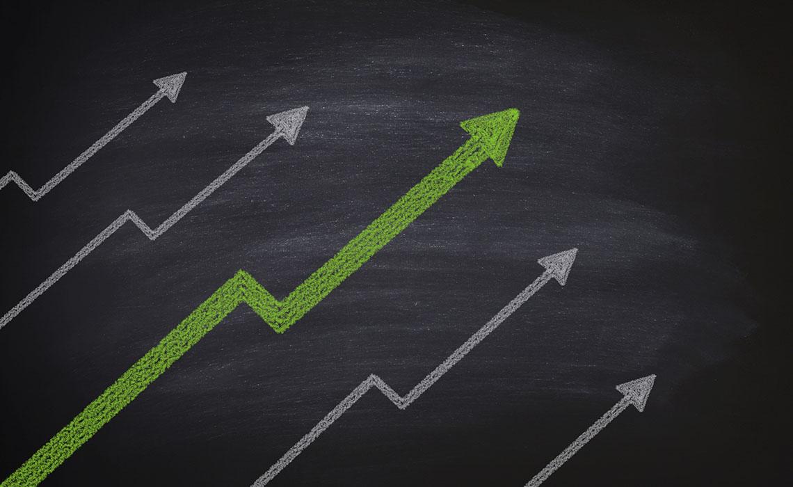 Increase in stocks on blackboard