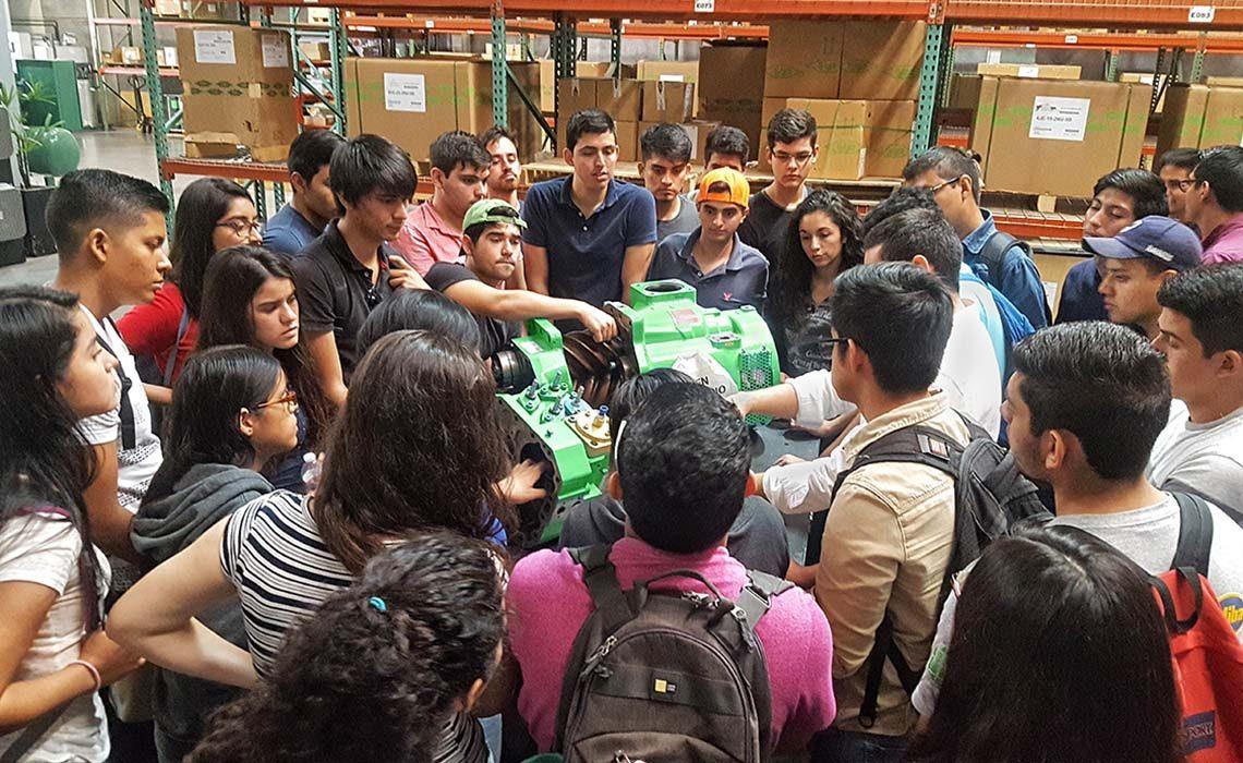 Students in Mexico examining a BITZER compressor