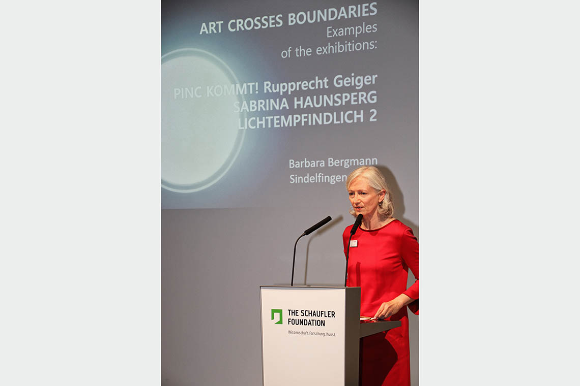 "Barbara Bergmann, member of the Management Board of THE SCHAUFLER FOUNDATION und director of the SCHAUWERK Sindelfingen, on the podium during her speech about ""Art crosses Boundaries"""