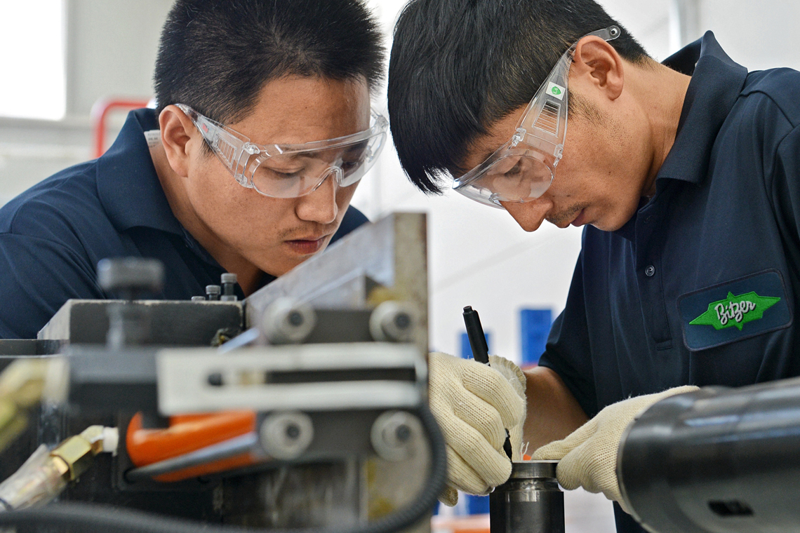 Maximum concentration: BITZER Industrial Equipment (BIE) specialists completing detailed work by hand