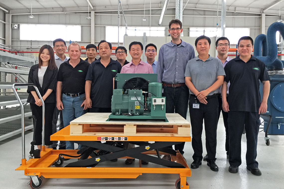 The BITZER Industrial Equipment (BIE) team with the first BITZER condensing unit manufactured in China