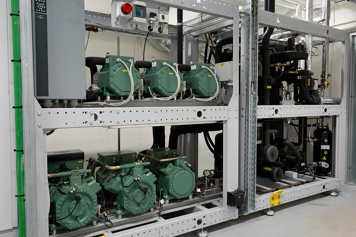 Green BITZER reciprocating compressors with IQ modules in metal frame